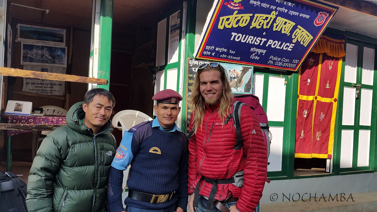 My guide checking in with the tourist police